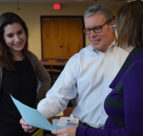 staff reviewing paperwork