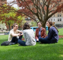 Students sitting in a field photo